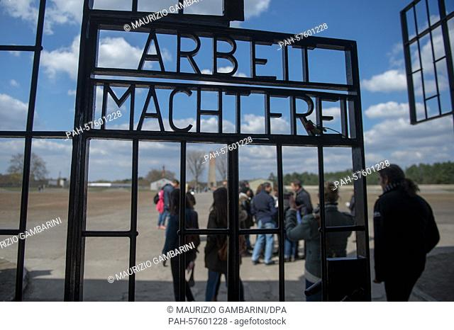 Visitors walk through the gate written with 'Work makes you free' on the 70th anniversary of the liberation of the Sachsenhausen concentration camp in...