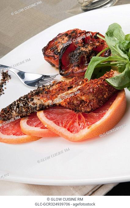 Close-up of pepper coated chops with grapefruit
