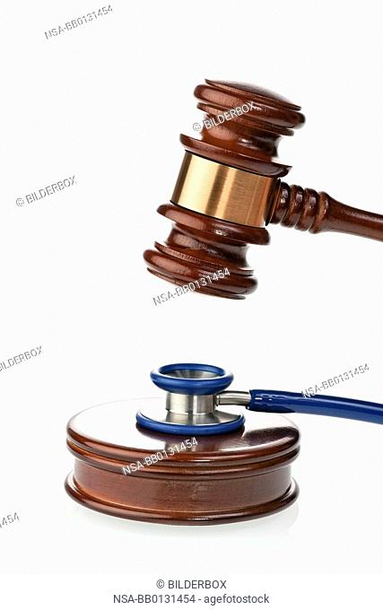 Stethoscope and judges hammer as a symbol for malpractice