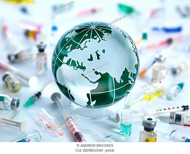 Global Pandemic, Globe of the world surrounded by drugs, vaccines and syringes