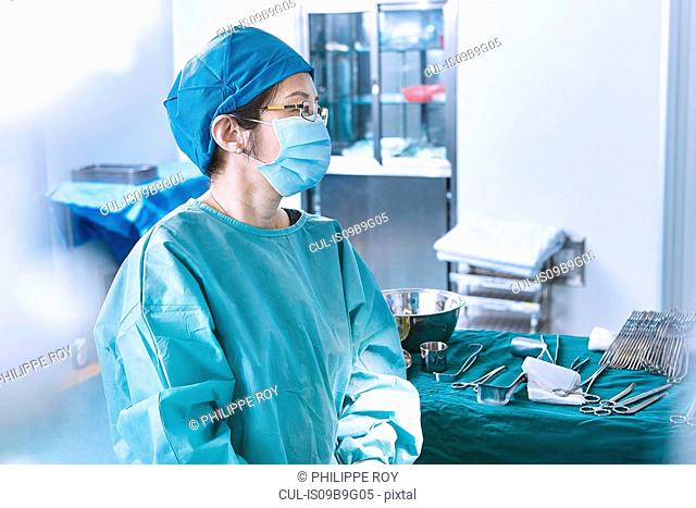 Surgeon performing surgery in maternity ward operating theatre