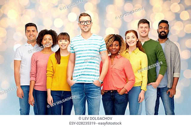 diversity, race, ethnicity and people concept - international group of happy smiling men and women over holidays lights background