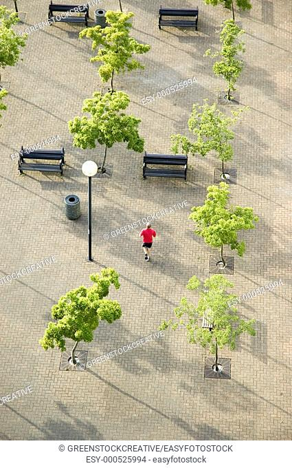 overhead view of a runner jogging through a plaza  Vancouver, British Columbia, Canada