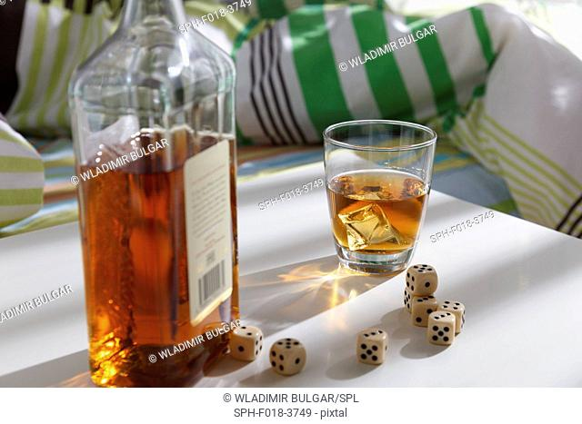 Whiskey bottle with dice
