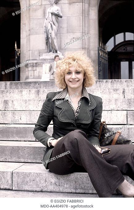 Raffaella Carrà in London. Italian TV presenter, actress, singer and showgirl Raffaella Carrà (Raffaella Maria Roberta Pelloni) sitting on a staircase