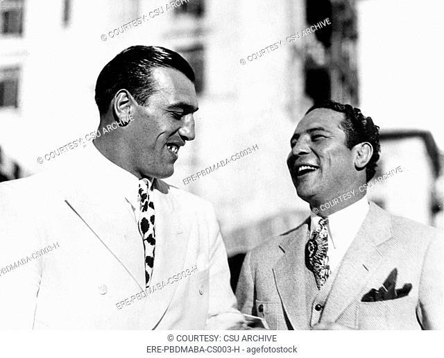 Primo Carnera & Max Baer Sr.being social at Biltmore Country Club, Coral Gables, FL, 1/30/34