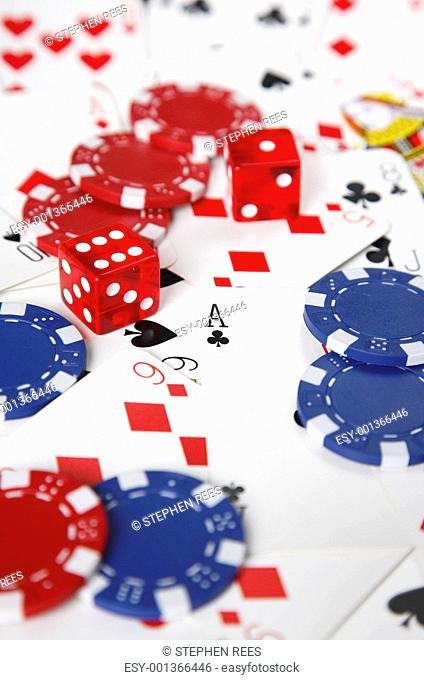 Gambling cards, chips and dice with shallow focus
