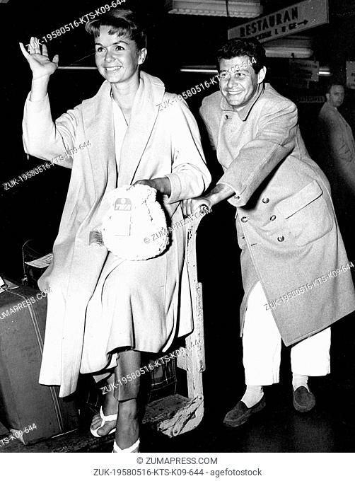 May 16, 1958 - Los Angeles, CA, U.S. - Actress DEBBIE REYNOLDS and her singer husband EDDIE FISHER with their baggage on their arrival from Los Angeles