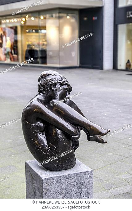 Statue of a young girl balancing in Rotterdam, The Netherlands, Europe