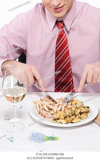 Close-up of a businessman having lunch