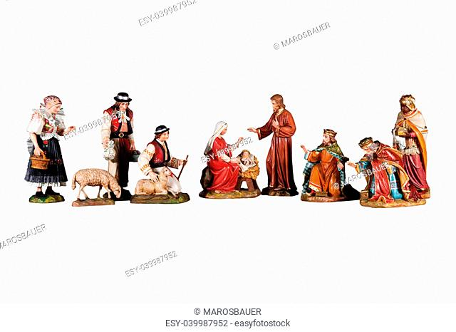 Wooden Sculptures nativity scene, depicting the family of God, three kings and the shepherds, isolated on white background
