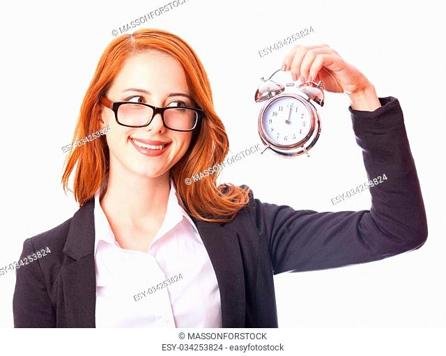 Redhead girl with clock on white background