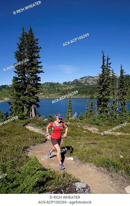 Trail running on the Rainbow Trail to Rainbow Lake. Whistler, British Columbia
