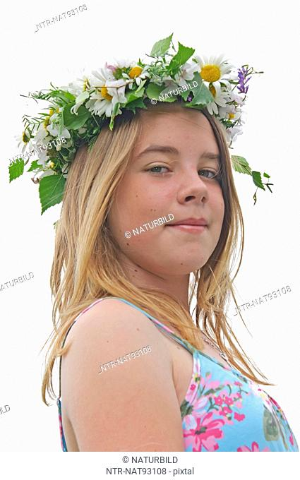 Girl wearing midsummer daisy wreath