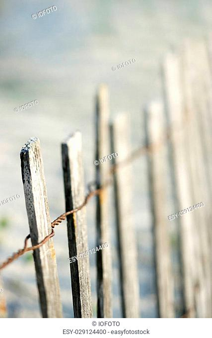 Weathered wooden fence on beach on Bald Head Island, North Carolina