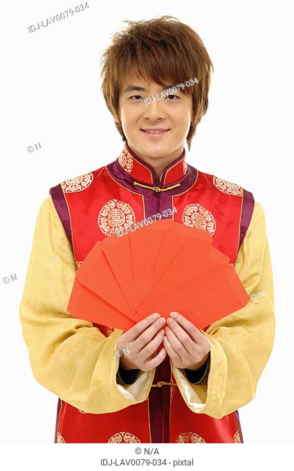 Man holding red envelopes and smiling