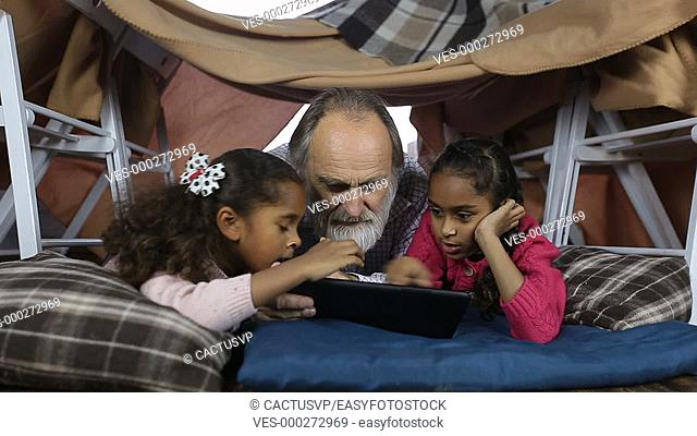 Clever kids showimg grandpa how to use touchpad