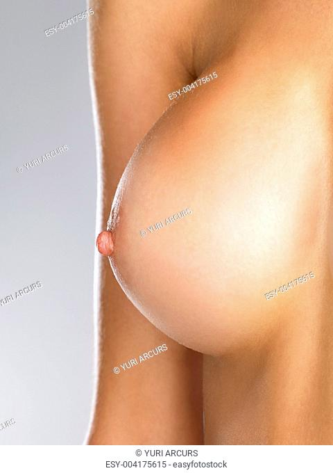 Closeup of a single womans breast view from the side