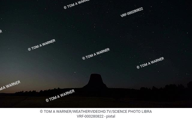 Timelapse footage of the moon rising over Devil's Tower. Filmed in Wyoming, USA, in summer