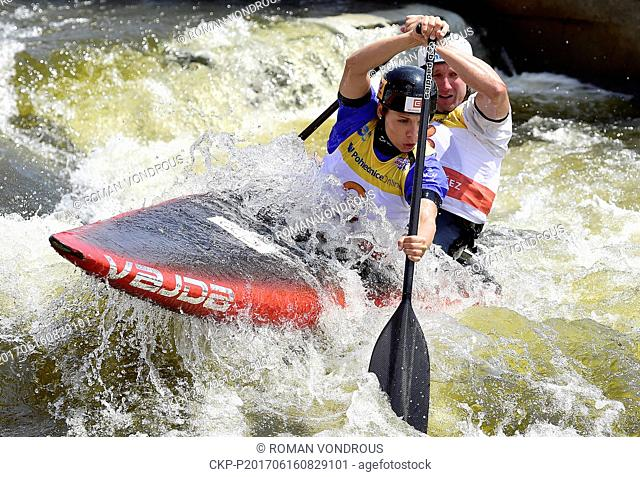 Veronika Vojtova (left) and Jan Masek of the Czech Republic competes in the Canoe double slalom mix heats during the 2017 ICF Canoe Slalom World Cup in Prague