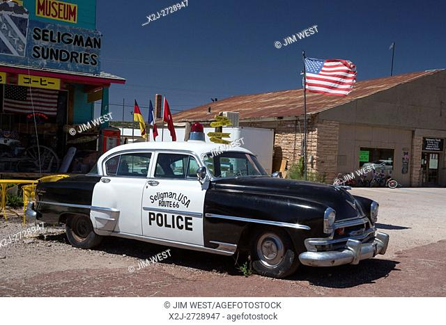 Seligman, Arizona - Souvenir shops and other tourist attractions line US Route 66. A Chrysler New Yorker (approximately 1954) was used as a police car