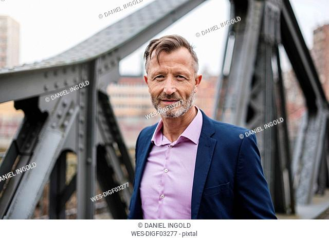 Portrait of smiling mature businessman outdoors