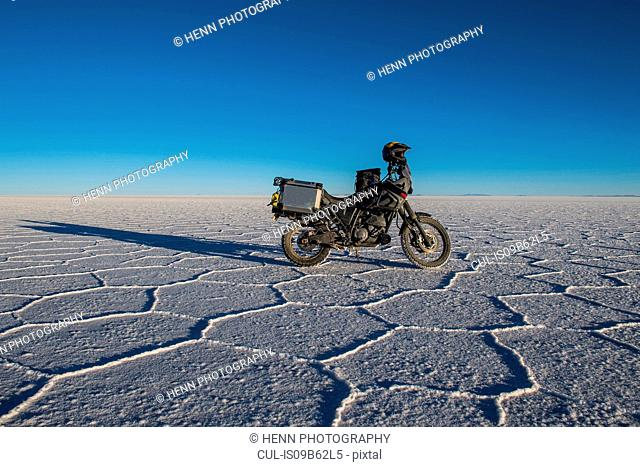 Parked motorcycle on the salt flats of Uyuni, Potosi, Bolivia, South America