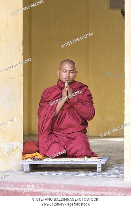 Monk meditating, Shwezigon Paya, Bagan, Myanmar