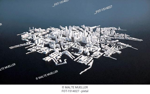 High angle view of cityscape model over gray background