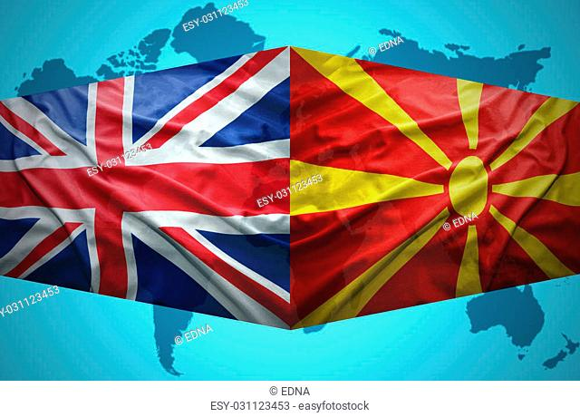 Waving Macedonian and British flags of the political map of the world