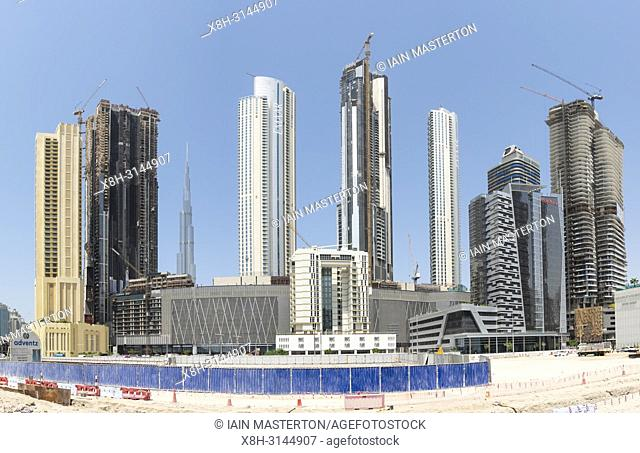 View of new high rise apartment towers under construction at Downtown Dubai , UAE, United Arab Emirates