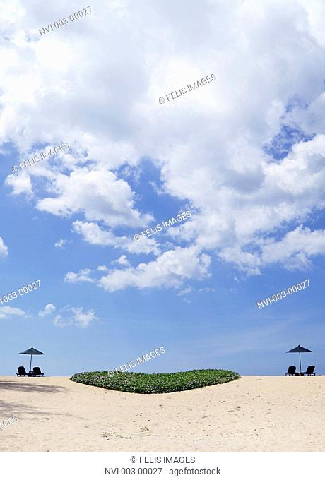 Dream beach with sun loungers and a green heart from plants, Phuket, Southern Thailand, Thailand, Southeast Asia
