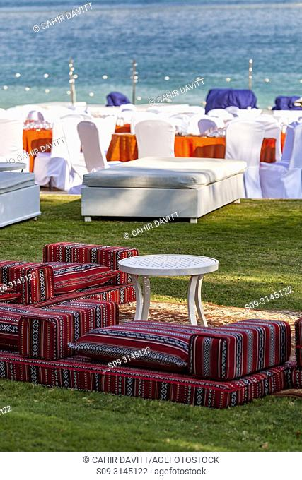 Realxed seating at the beach at the Atlantis 5 star resort complex, Palm Jumeirah, Dubai, The United Arab Emirates