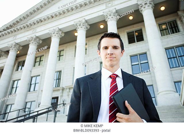 Caucasian businessman standing outdoors