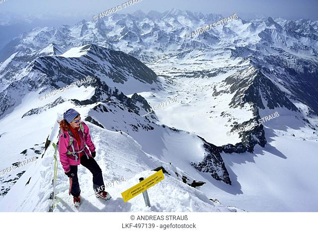 Woman ascending to Grossglockner, Glockner Group, High Tauern National Park, East Tyrol, Tyrol, Austria