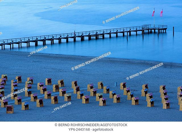 beach at the Baltic Sea with beach chairs at dusk, Travemünde, Schleswig-Holstein, Germany