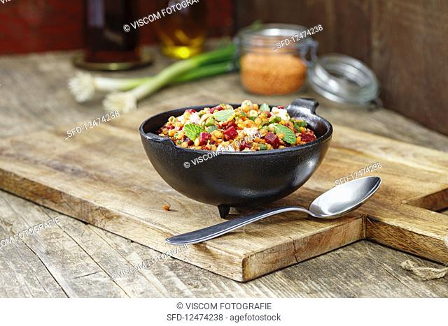 Red lentil salad with spring onions