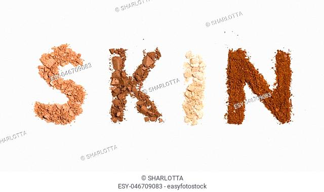 inscription skin from tonal bases of decorative cosmetics on white background. Beauty and makeup concept
