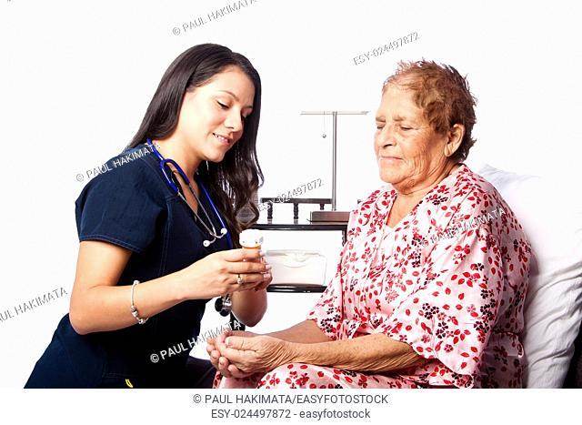 Nurse explaining prescription medication to senior patient, home medical health concept