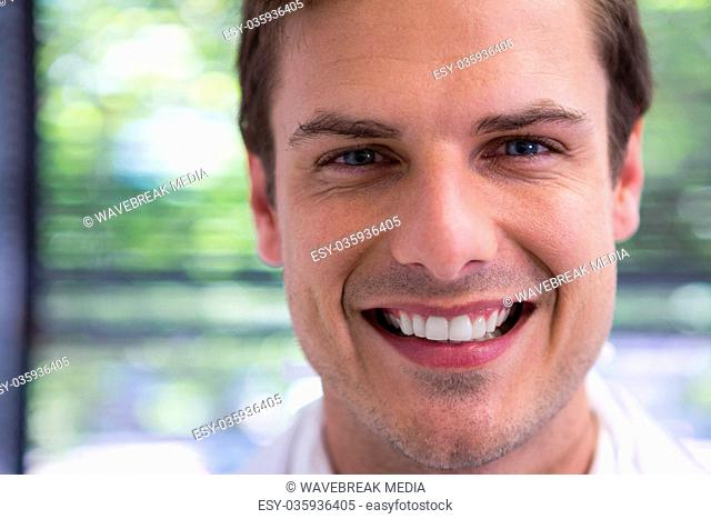 Close up portrait of smiling doctor