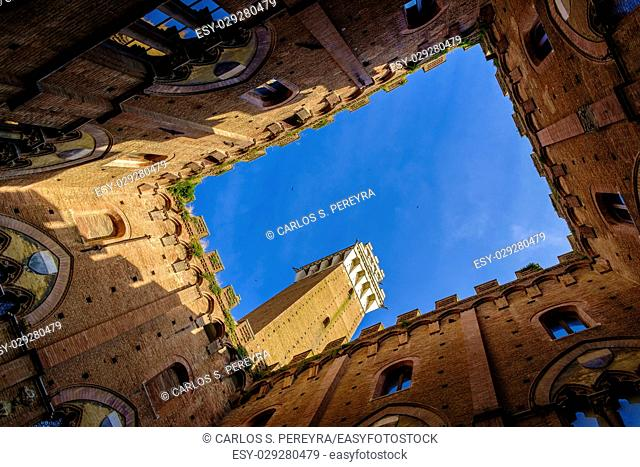 Piazza del Campo is the main square of Siena with view on Palazzo Pubblico and its Torre del Mangia