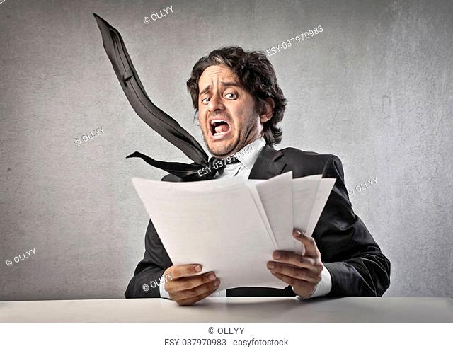 businessman gets scared by reading his documents