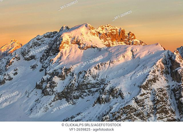 Europe, Italy, Veneto, Belluno. Mount Cernera (2657 m. ) snow covered at sunset seen from the mountain Pore. Dolomites