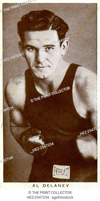 Al Delaney, Canadian boxer, 1938. Born Alex Borchuk, Delaney (1916-1997) fought at heavyweight. His career included 102 fights, with 64 wins