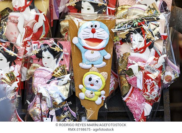 A Hagoita (Battledore) decorated with the manga series character Doraemon (C) on display during the Hagoita-Ichi fair at the Sensoji Temple in Asakusa