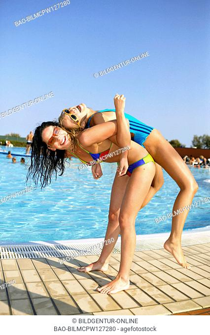 two women having fun at the pool