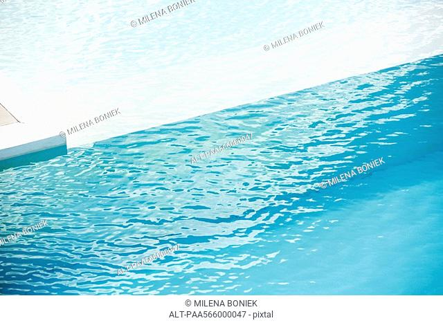 Swimming pool with ledge separating deep and shallow ends