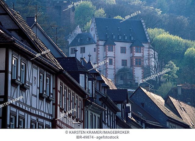 Germany: Miltenberg on the Main river, Bavaria, timber framed houses in the mainstreet Hauptstrasse, BG the medivial Mildenburg , in spring time light