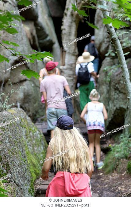 Family walking among rocks