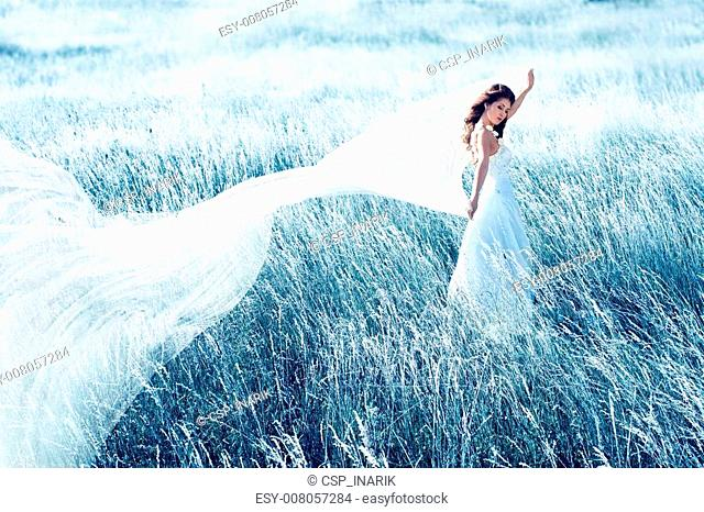 bride in blue field with waving fabric